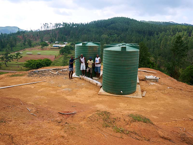 The solar powered borehole is connected to there three elevated storage tanks, which distribute water to 34 households in Cobue settlement.