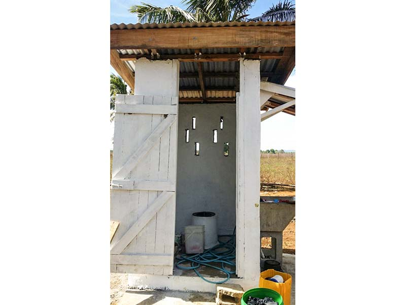 One of two pour flush toilets designed by our engineers and built by the community