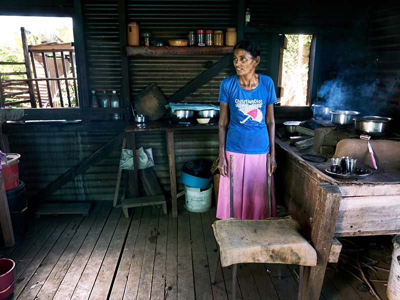 Savitiri preparing lunch in her kitchen shows the value of safer drinking water in households. While construction was underway in Cobue Settlement, Savitiri and her husband Deo kindly opened their doors to out plumber field staff. Savitiri prepared daily meals for the plumbers, and the couple provided comfortable accommodation in the cottage.