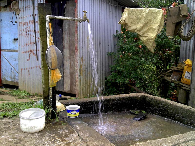 Testing the water pressure of a tap stand in Jioma village