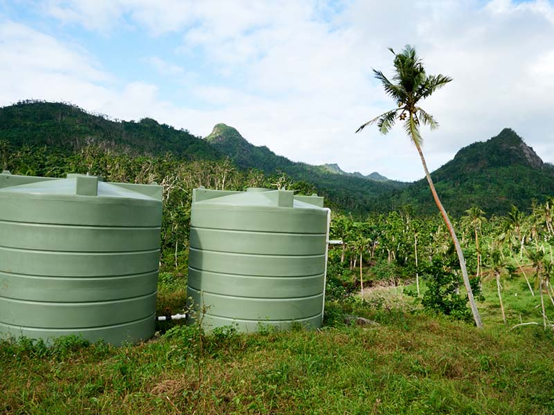 Water travels through pipes from a protected catchment area to these two large distribution tanks.