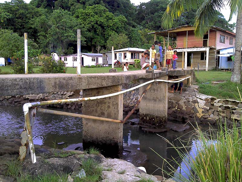 The main water pipe to Nacomoto village crosses a river