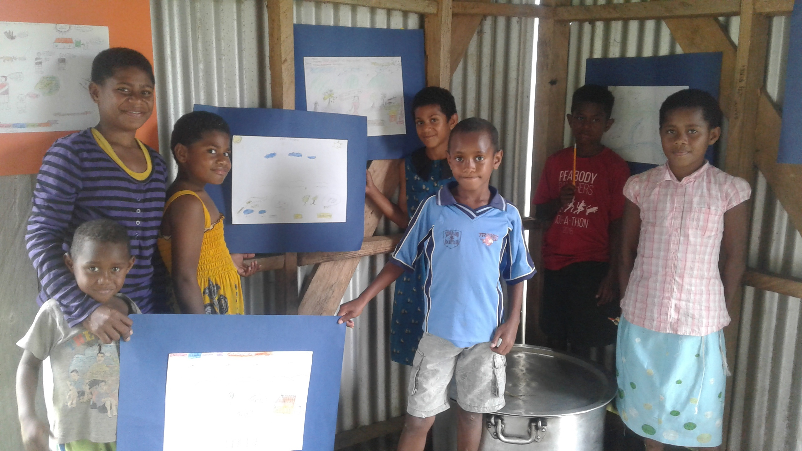 chidren of waisa with their artwork