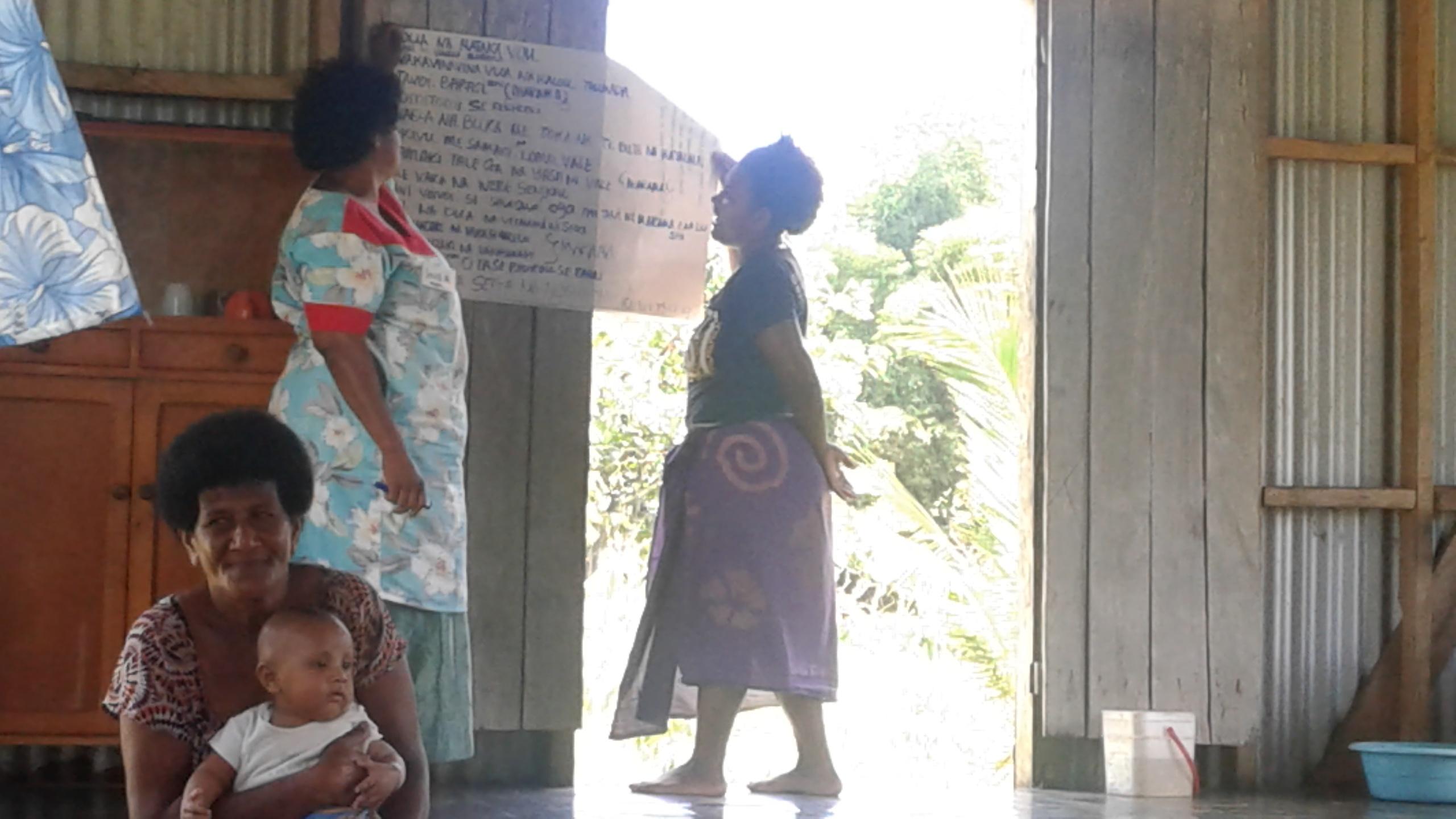 women in Waisa presenting their group work